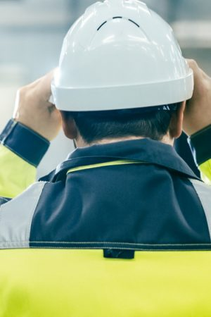 Back,View,Shot,Of,The,Industrial,Engineer,Wearing,Protective,Clothing